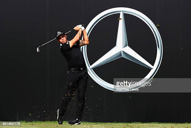 Rickie Fowler of the United States tees off on the 12th hole during a practice round ahead of the Abu Dhabi HSBC Championship at Abu Dhabi Golf Club...