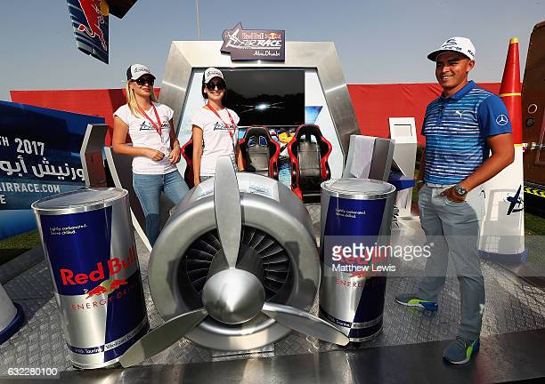 Rickie Fowler of the United States visits the Red Bull Stand in the Championship village during day three of the Abu Dhabi HSBC Championship at Abu...