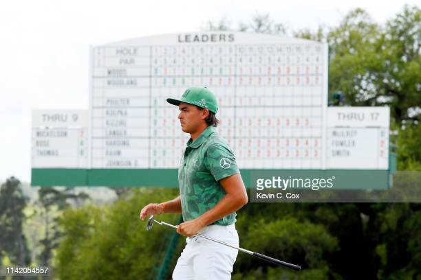Rickie Fowler of the United States walks across the 18th green during the first round of the Masters at Augusta National Golf Club on April 11 2019...