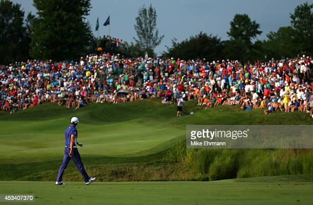 Rickie Fowler of the United States walks across the 18th hole during the third round of the 96th PGA Championship at Valhalla Golf Club on August 9,...