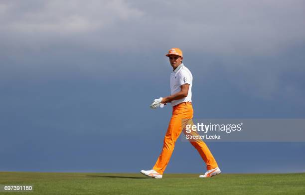 Rickie Fowler of the United States walks across the eighth hole during the final round of the 2017 US Open at Erin Hills on June 18 2017 in Hartford...