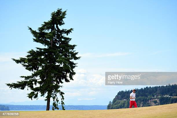 Rickie Fowler of the United States walks across the third green during the first round of the 115th US Open Championship at Chambers Bay on June 18...