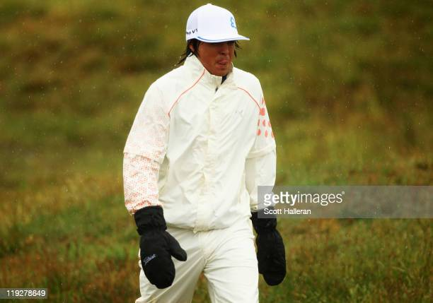 Rickie Fowler of the United States walks on the 7th hole during the third round of The 140th Open Championship at Royal St George's on July 16, 2011...