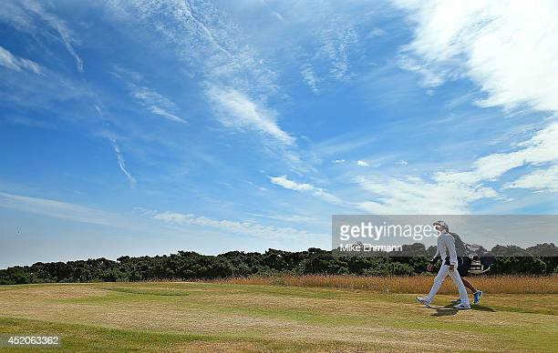 Rickie Fowler of the United States walks up the first hole during the third round of the 2014 Aberdeen Asset Management Scottish Open at Royal...