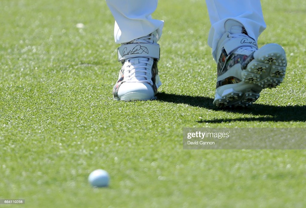 Rickie Fowler of the United States wears a very special tribute pair of golf shoes adorned with the signature and images of Arnold Palmer during the first round of the 2017 Arnold Palmer Invitational presented by MasterCard on March 16, 2017 in Orlando, Florida.
