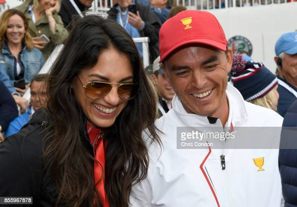 Rickie Fowler of the US Team and girlfriend Allison Stokke on the first tee during the afternoon fourball matches at the Presidents Cup at Liberty...