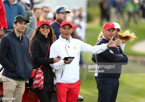 Rickie Fowler of the US Team and girlfriend Allison Stokke watch the action during the afternoon fourball matches at the Presidents Cup at Liberty...