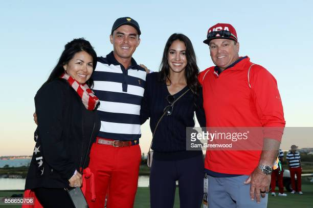 Rickie Fowler of the US Team celebrates with his parents Lynn and Rod and girlfriend Allison Stokke after he and the US Team defeated the...