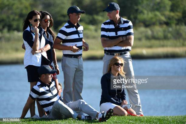 Rickie Fowler of the US Team Jim Furyk Captains Assistant of the US Team and Justin Thomas of the US Team watch from the course along with their...