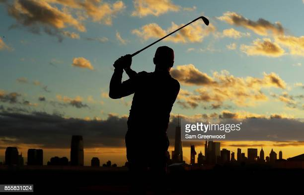 Rickie Fowler of the US Team practices on the range prior to Saturday foursome matches of the Presidents Cup at Liberty National Golf Club on...