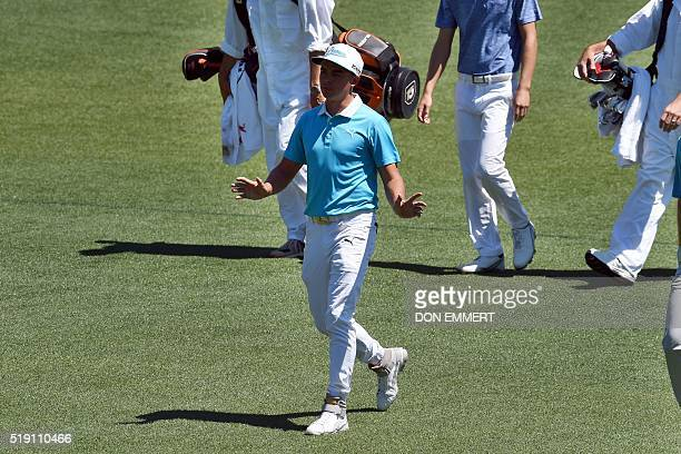 Rickie Fowler of the US walks on the fairway of the 1st hole during a practice round prior to the start of the 80th Masters Golf Tournament at the...