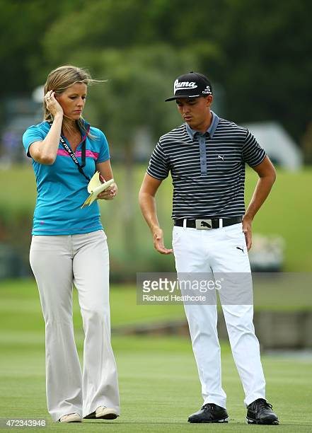Rickie Fowler of the USA chats with Golf Channel host Kelly Tilghman during a practice round for THE PLAYERS Championship at the TPC Sawgrass Stadium...