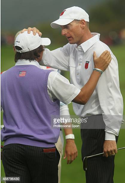 Rickie Fowler of the USA is congratulated by Jim Furyk on the 18th green after they halved their match during the rescheduled Afternoon Foursome...