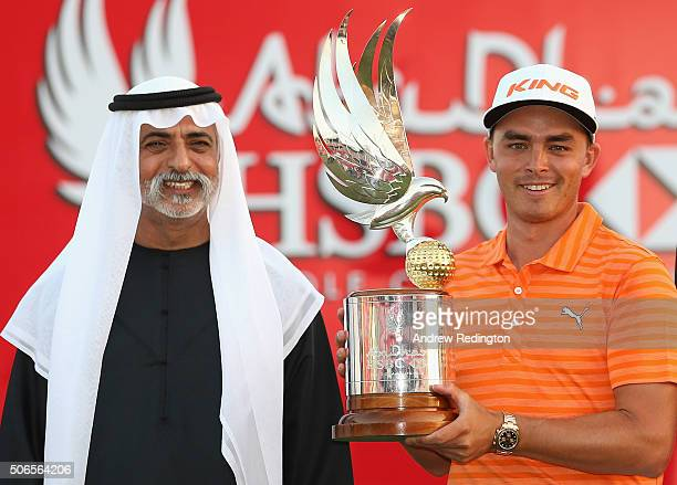 Rickie Fowler of the USA is presented with the trophy by His Excellency Sheikh Nahyan Bin Mubarak Al Nayhan UAE Minister of Culture Youth and Social...