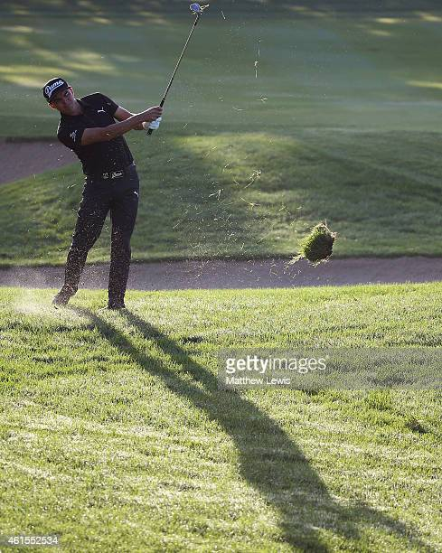Rickie Fowler of the USA plays a shot from the 10th fairway during the first round of the Abu Dhabi HSBC Golf Championship at Abu Dhabi Golf Club on...