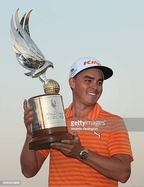 Rickie Fowler of the USA poses with the trophy after winning the Abu Dhabi HSBC Golf Championship at the Abu Dhabi Golf Club on January 24 2016 in...
