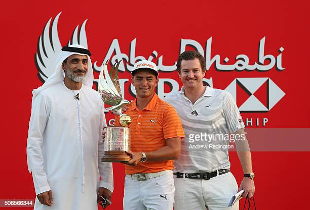 Rickie Fowler of the USA poses with the trophy alongside dignitaries after winning the Abu Dhabi HSBC Golf Championship at the Abu Dhabi Golf Club on...