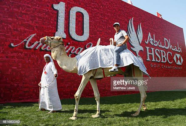 Rickie Fowler of the USA rides a camel following his round during day three of the Abu Dhabi HSBC Golf Championship at Abu Dhabi Golf Club on January...