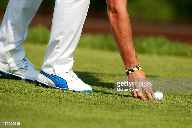 Rickie Fowler places his ball during the second round of the Travelers Championship held at TPC River Highlands on June 21 2013 in Cromwell...