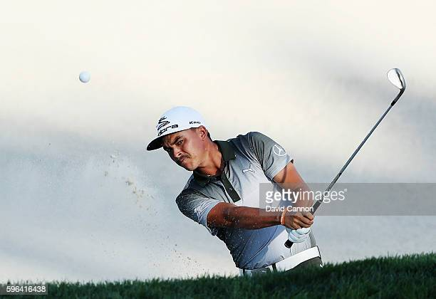 Rickie Fowler plays a bunker shot on the 17th hole during the third round of The Barclays in the PGA Tour FedExCup Play-Offs on the Black Course at...
