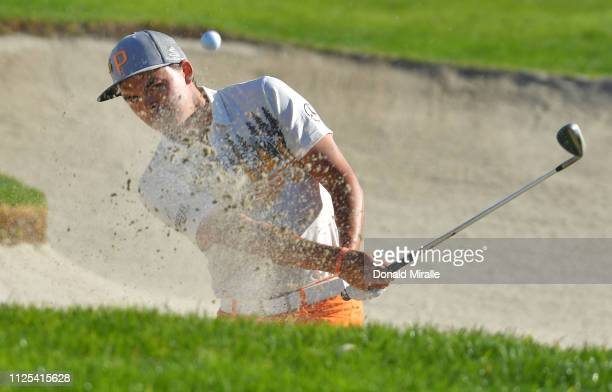 Rickie Fowler plays a shot from a bunker on the 12th hole on the South Course during the final round of the the 2019 Farmers Insurance Open at Torrey...