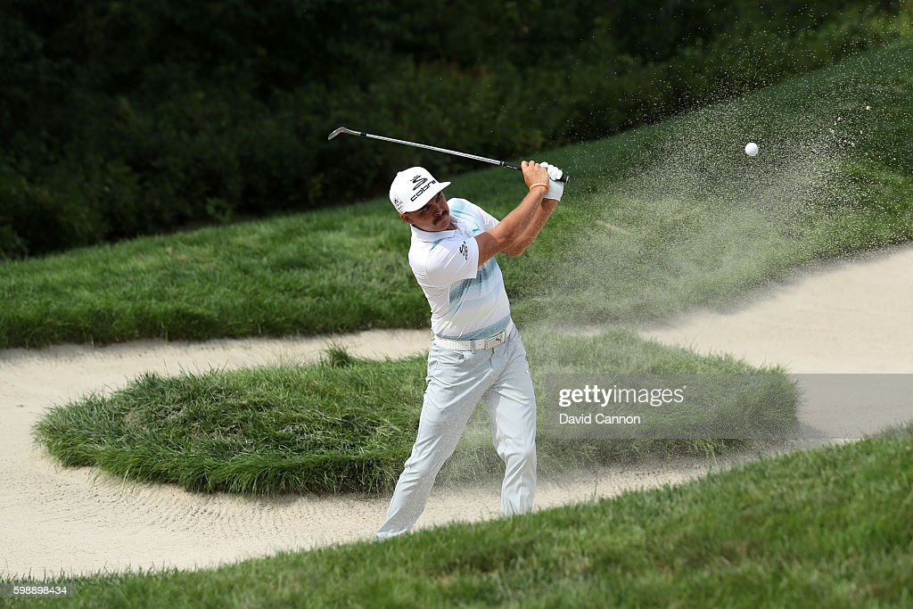Rickie Fowler plays a shot from a bunker on the 18th hole during the second round of the Deutsche Bank Championship at TPC Boston on September 3, 2016 in Norton, Massachusetts.