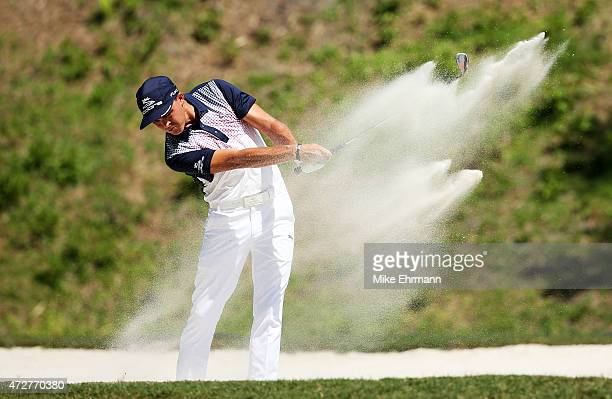 Rickie Fowler plays a shot from a bunker on the sixth hole during round three of THE PLAYERS Championship at the TPC Sawgrass Stadium course on May 9...