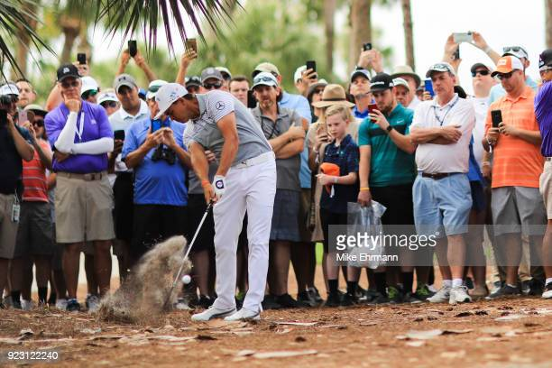 Rickie Fowler plays a shot from the rough on the eighth hole during the first round of the Honda Classic at PGA National Resort and Spa on February...