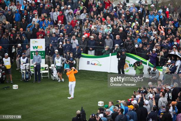 Rickie Fowler plays a tee shot on the 11th hole during the final round of the Waste Management Phoenix Open on February 03 2019 in Scottsdale Arizona