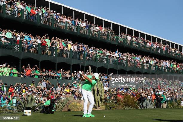 Rickie Fowler plays a tee shot on the 16th hole during the third round of the Waste Management Phoenix Open at TPC Scottsdale on February 4 2017 in...