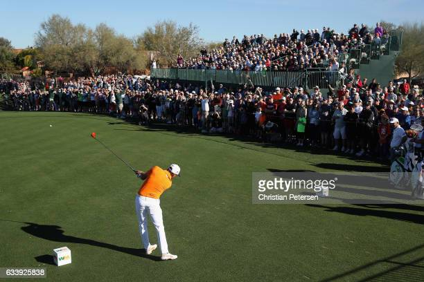 Rickie Fowler plays a tee shot on the first hole during the final round of the Waste Management Phoenix Open at TPC Scottsdale on February 5, 2017 in...