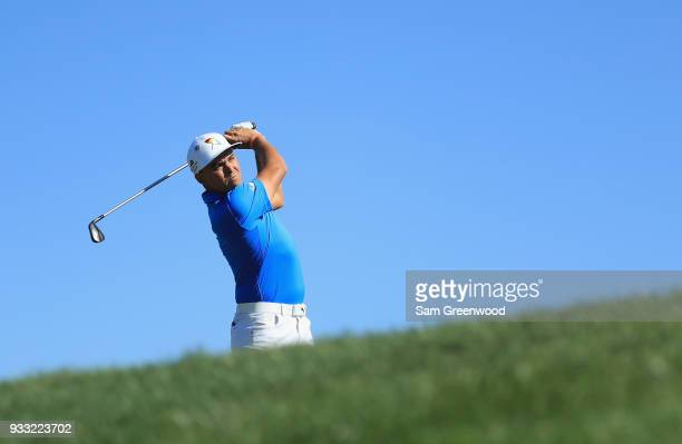 Rickie Fowler plays his shot from the 14th tee during the third round at the Arnold Palmer Invitational Presented By MasterCard at Bay Hill Club and...