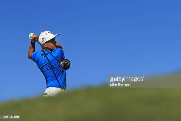 Rickie Fowler plays his shot from the 16th tee during the third round at the Arnold Palmer Invitational Presented By MasterCard at Bay Hill Club and...