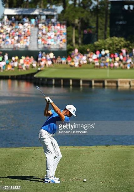 Rickie Fowler plays his shot from the 17th tee during round one of THE PLAYERS Championship at the TPC Sawgrass Stadium course on May 7, 2015 in...