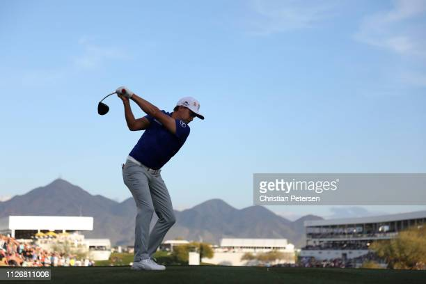 Rickie Fowler plays his shot from the 17th tee during the second round of the Waste Management Phoenix Open at TPC Scottsdale on February 01, 2019 in...