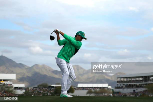 Rickie Fowler plays his shot from the 17th tee during the third round of the Waste Management Phoenix Open at TPC Scottsdale on February 02, 2019 in...