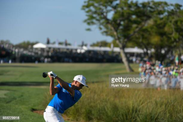 Rickie Fowler plays his shot from the 18th tee during the third round of the Arnold Palmer Invitational presented by MasterCard at Bay Hill Club and...
