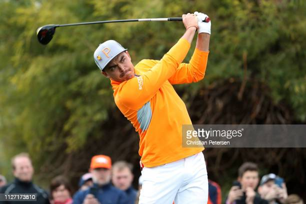 Rickie Fowler plays his shot from the ninth tee during the final round of the Waste Management Phoenix Open at TPC Scottsdale on February 03, 2019 in...
