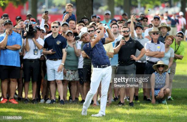 Rickie Fowler plays his shot on the 17th hole during round one of the Rocket Mortgage Classic at the Detroit Country Club on June 27, 2019 in...