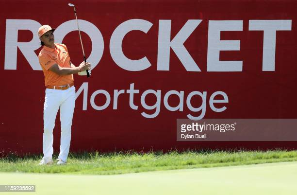 Rickie Fowler plays his shot on the 17th hole during the final round of the Rocket Mortgage Classic at the Detroit Country Club on June 30, 2019 in...