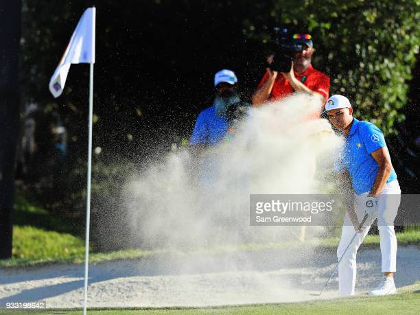 Rickie Fowler plays his shot out of the bunker for eagle on the 16th hole during the third round at the Arnold Palmer Invitational Presented By...