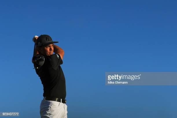 Rickie Fowler plays his tee shot on the 12th hole during the second round of the Honda Classic at PGA National Resort and Spa on February 23 2018 in...