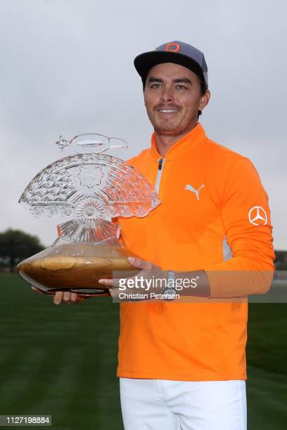 Rickie Fowler poses with the trophy after winning the Waste Management Phoenix Open at TPC Scottsdale on February 03, 2019 in Scottsdale, Arizona.