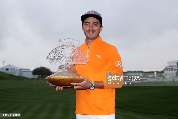 Rickie Fowler poses with the trophy after winning the Waste Management Phoenix Open at TPC Scottsdale on February 03 2019 in Scottsdale Arizona