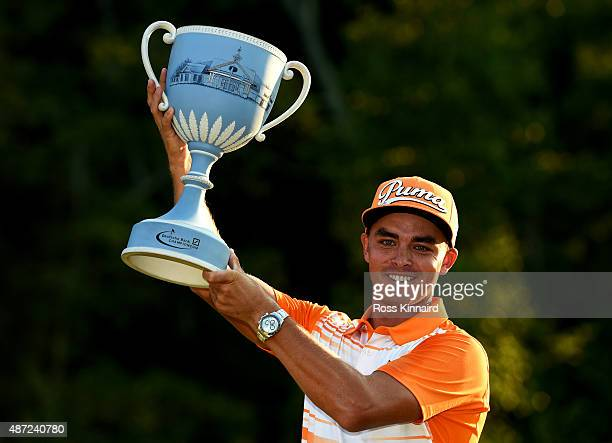 Rickie Fowler poses with the winner's trophy after winning the Deutsche Bank Championship at TPC Boston on September 7, 2015 in Norton, Massachusetts.