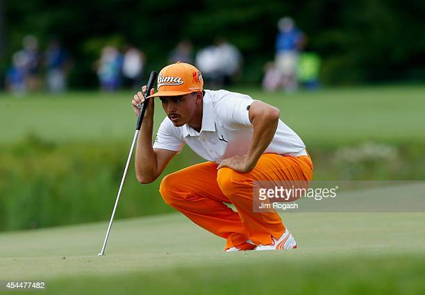 Rickie Fowler prepares to putt on the second hole during the final round of the Deutsche Bank Championship at the TPC Boston on September 1 2014 in...