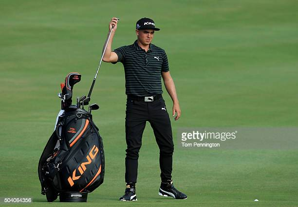 Rickie Fowler pulls a club from his bag on the 17th hole during round two of the Hyundai Tournament of Champions at the Plantation Course at Kapalua...