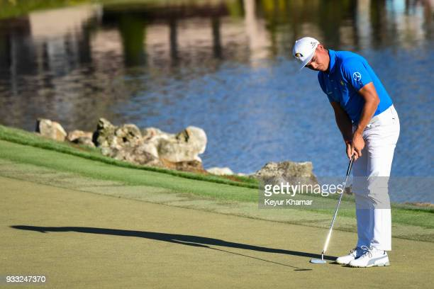 Rickie Fowler putts for bogey on the 18th hole green during the third round of the Arnold Palmer Invitational presented by MasterCard at Bay Hill...