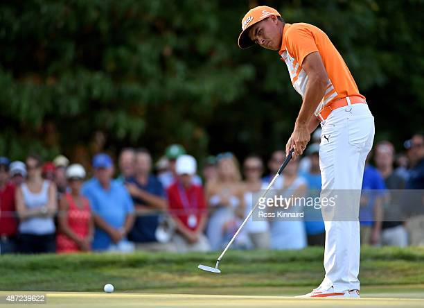 Rickie Fowler putts on the 14th green during the final round of the Deutsche Bank Championship at TPC Boston on September 7 2015 in Norton...