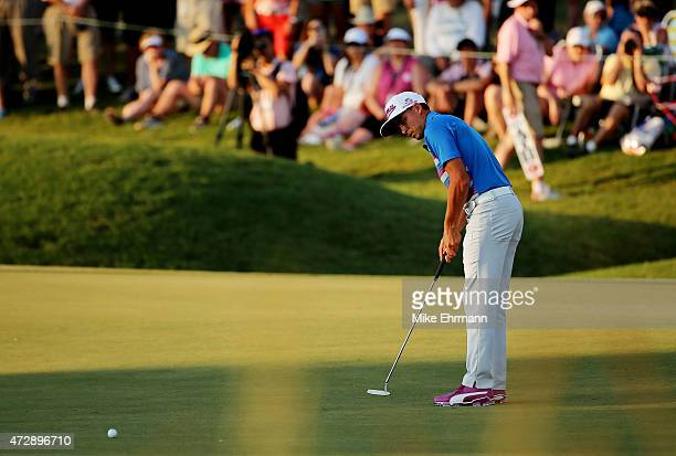 Rickie Fowler putts on the 16th green during a playoff in the final round of THE PLAYERS Championship at the TPC Sawgrass Stadium course on May 10...